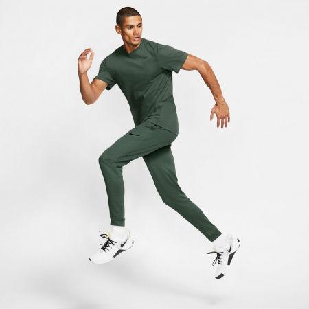 Pánské tréninkové kalhoty - Nike DRI-FIT - 5