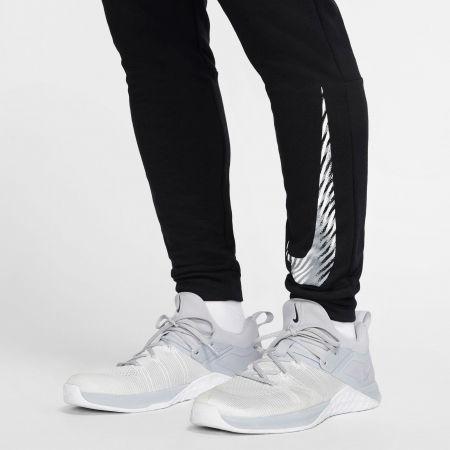 Men's training pants - Nike DRY PANT TAPER FLC GFX M - 7